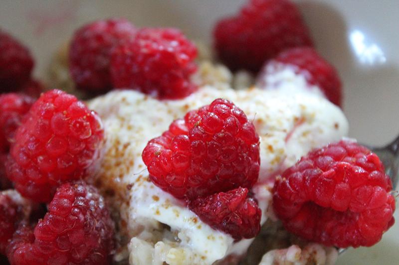 close-up-of-raspberries-in-oatmeal-bowl
